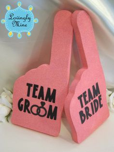 Put disposable cameras everywhere at the wedding reception and put these foam fingers with them for your guests to take pictures with...love it!