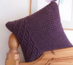 Purple Cushion / Throw Pillow . Hand knitted in red flecked purple 100% wool with cable decoration for home decor OOAK via Etsy