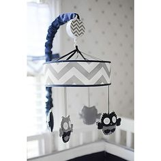 Featuring graphic prints in navy, grey and white, the Out of the Blue collection from My Baby Sam will give your little one's nursery a fresh, modern style. The Musical Mobile features hand-stitched navy and grey owls who dance to Brahms' Lullaby.