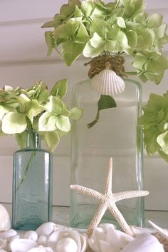 Beachy inspiration - DIY dried hydrangeas, shells, starfish, twine and tinted bottles.
