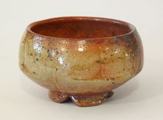 Shino altered tea bowl, wood-fired soda glazed stoneware, 2014 by David Voorhees
