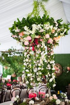 Gorgeous multi colored chandelier by Kate Dawes Floral Design. Love how the white blooms almost touch the table below