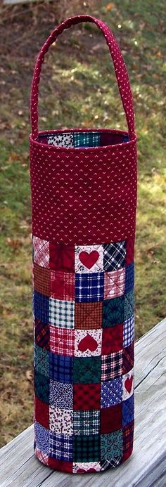 Quilted Bottle-Wine Tote Topper Style - Blocks Red. $8.00, via Etsy.