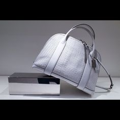 "HOST PICK 2x  BLEECKER PRESTON NWT  authentic Coach Bleecker woven preston Satchel                                            Color : Silver white  woven leather; inside zip, cell phone and multifunction pockets; outside slit pocket; zip-top closure, fabric lining; handles with 4 1/2"" drop; longer strap for shoulder wear; 14 3/4"" (l) x 10 1/2"" (h) x 6 1/4"" (w).   Comes with dust bag , coach card & coach key chain tag .  ( no paypal ) Coach Bags"