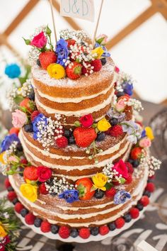 naked wedding cake with wildflowers and carefully crafted details