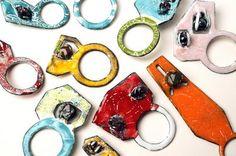 Rings by Tabea Reulecke, enamel on copper with garnets