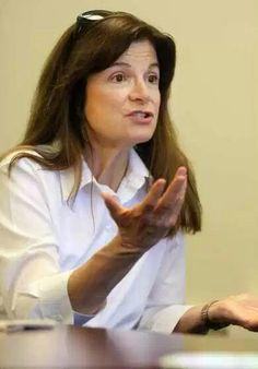 Carolyn Porco. Astronomer.