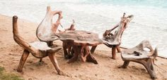 Picture of The chairs and table made from tree root on the beach stock photo, images and stock photography.
