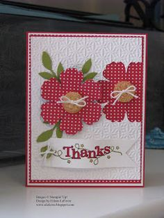 handmade card .... two mixed bunch flowers in red with white polka dots ... one on top of the card and one in the negative space beside ite ... like it!! ... Stampin' Up!