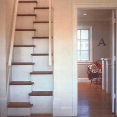 """Another version of the alternate-tread stair. """"For spatial frugality, nothing short of a ladder can compete ... tread depth and the rise from step to step is the same as on a normal stair, but ... the run is reduced by half. Obtaining approval for a set will usually be a matter of negotiation with your local [building] inspector."""