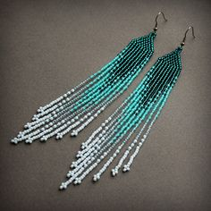 Long beaded earrings. Turquoise ombre earrings. These earrings made with tiny japanese seed beads. Ear wires are surgical steel.  Length - 15 cm / 5.9 inches (including ear wires). Width - 2 cm / 0.8 inches  More seed bead earrings from my shop you can see here: https://www.etsy.com/shop/HappyBeadwork?section_id=18816158