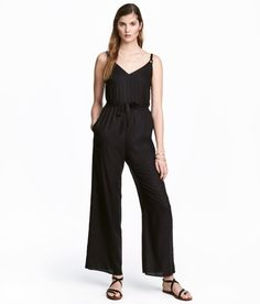 Check this out! Jumpsuit in soft, woven fabric with narrow adjustable shoulder straps, V-neck at front, and opening at back of neck with concealed button. Side pockets, seam at waist with tie belt, and straight, wide legs. Unlined. - Visit hm.com to see more.