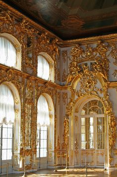 I think this might be the palace of Versailles. But the light blue and gold in the sunlight makes this room so warm!