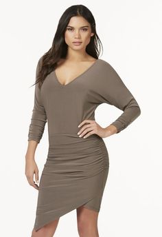 Comfort is the name of the game and this dress will have you looking chic in a matter of seconds. It features dolman sleeves, a crossover front skirt and a jersey knit that's lightweight and airy....