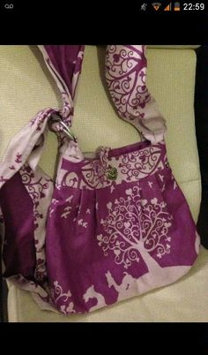 Baby wearing bag using sling fabric and 2 ring slings