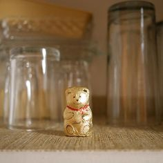 """When I was a kid, an """"elf"""" used to leave treats for me in the dish cupboard. This one greeted me when I reached for a beer glass in my parents' kitchen tonight. Never too old for a surprise chocolate bear!"""
