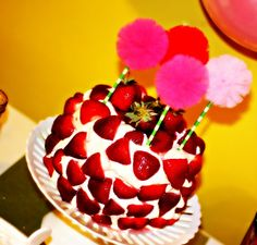 Love this strawberry cake with the pom poms