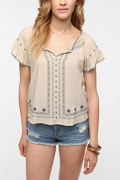1920's bohemian chic blouse. There was a brief trend for all thinks folk art in clothing during the 1920's. http://www.vintagedancer.com/1920s/shopping-for-1920s-style-blouses/