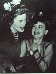 Joan Fontaine & sister Olivia de Havilland at the 1942 Oscars...Uploaded By www.1stand2ndtimearound.etsy.com