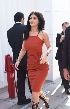Looking for a similar orange bodycon dress as the one Kylie Jenner is wearing