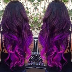Dark plum purple roots with dyed bright purple colored hair. Long hair with curls. Color. Colour.