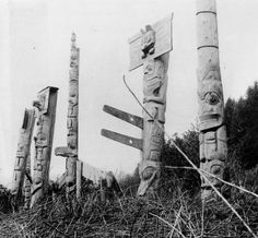 Cumshewa Poles associated with the Frog House and the House in Which There is Light. Creator/photographerC.F. Newcombe: Bill Reid Centre Collection