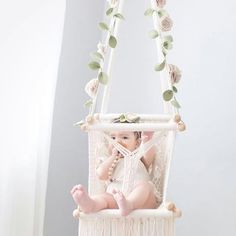 Gorgeous handmade macrame baby swing with a custom floral garland from This macrame hammock for babies and toddlers is Baby Hammock, Baby Swings, Hammock Swing, Baby Dekor, Baby Clothes Storage, Flower Mobile, Easy Baby Blanket, Floral Garland, Nursery Neutral