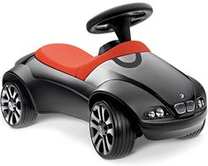 Your kid not happy with bigwheels... screw the recession bmw baby racer