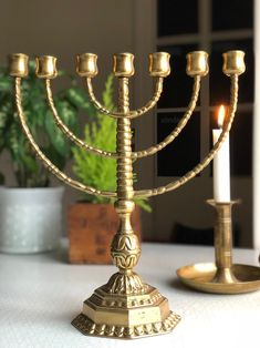 Excited to share this item from my shop: Solid heavy brass / bronze menorah 7 arm vintage pedestal stunning/ brass authentic patina Menorah, Small Island, Pedestal, Solid Brass, Vintage Items, Candle Holders, Arm, Bronze, Candles
