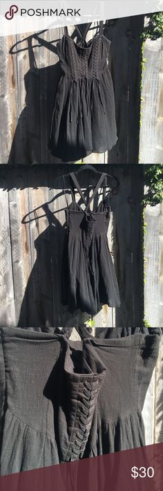 Free People Black Lace-up Baby Doll Dress This dress is so flirty & sexy! The front lace-up detail is very hott and the flowy skirt keeps it cute. It's not too short and perfect for running around town in the summer. It has only been worn twice but there's a tiny bit of white staining in the under arm area, the dress has been cleaned though! Other than that, great condition. It is a size 2 but I'm normally a 6 and this fit fine for me. Free People Dresses Mini