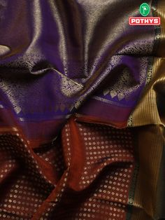 The rare blend of brown and violet Samudrika silk saree with delicate needlework in the body of the saree and the contrast combination of the pallu gives your whole look a different emotion. #ethnicsarees #grandsaree #silksaree #puresilk #saree #traditionalsaree #sareedesigns #sareestyles #weddingsaree #handwovensarees #sareedrapping #sareelooks #sareeforteenagers #samudrikasilksarees #samudrikasarees #handloomsaree #pattusaree #bridalsaree #muhurthamsarees #sareeembroidery #BestSarees