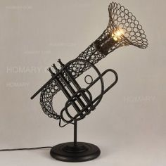 Musique 1-Light Carved Metal Saxophone Black Table Lamp & Round Base