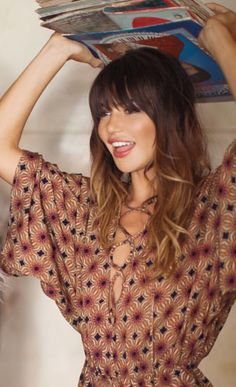 love the bangs! don't know if i could pull this off or not?