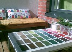 paint swatches on a beat up coffee table...