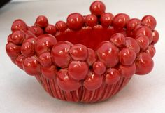 handmade ceramic pottery red pinch pot with round balls fixed to the rim