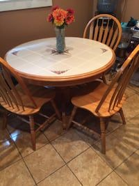 Used Round Brown Wooden Table With Four Chairs Dining Set For Sale