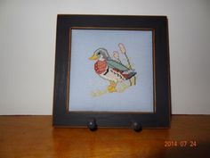 Finished-Cross-Stitch-picture-of-wood-duck-in-a-key-rack-frame