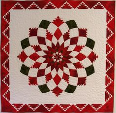Feathered Dahlia Christmas quilt by Gayle McKay. Published in the Dec/Jan 2010 issue of Quilters' Newsletter Magazine.