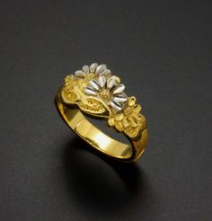 This ring is also made in Japan some decades ago.  A work of beautiful inlay and chasing.  (C) Kazuhiko Ichikawa collection