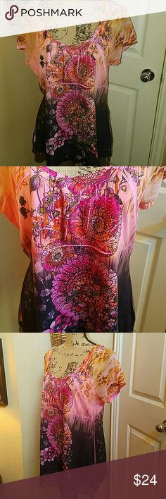 DARLING FLORAL PRINT TOP This is a beautiful top that is a multi color of black, pink and Peach. It has little glistening sequins on top of Bodice. Brand new without tags, this is 100% polyester. Just precious Bleu Tops Blouses