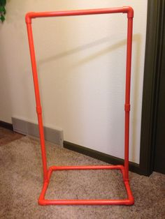 Orange costume rack. View this and more on my Facebook page at www.facebook.com/letspaintbykelly