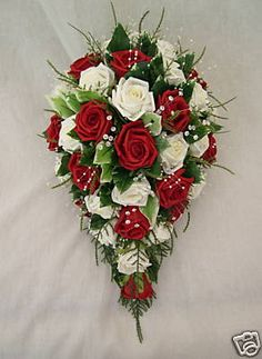 Allison, this one could be done with aqua ribbons and pearls instead of the greenery and use all red roses with a little white baby's breath.