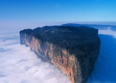 Mount Roraima is located on the triple border point between Brazil, Guyana and Venezuela. It is weird because of its shape, but is also mysterious because of the clouds that are always near the peak and the endemic fauna. The tabletop of the mountain, which is the peak actually, is considered as one of the world's oldest geological formations. It is believed that the plateau was formed by water and winds, but the reason why some species can't be found anywhere else remain mystery.
