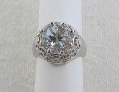 I have seen one of these, it was stunning!!   Filigree ring with large Mason County Texas topaz Lone Star Cut