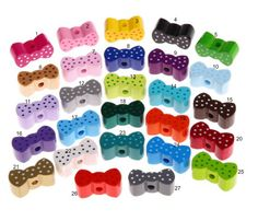 Wood bow shaped / motive beads by Toysforchildren on Etsy