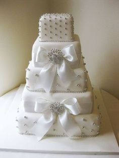 Cute! ... Minus bows... Square Wedding Cakes With Bling | Square Bling & Bows wedding cake / wedding cakes - Juxtapost