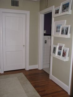 I like the white doors and wide white trim. The floor looks like my color. The ledges and frames are cute too Love Home, My Dream Home, Picture Shelves, Picture Ledge, Wedding Picture Walls, Dining Room Walls, White Doors, Reading Room, Home Renovation