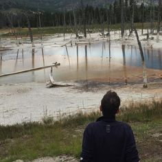 Lucas pondering the Opalescent Pool at Yellowstone National Park in Wyoming.