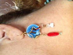 Red white and blue earrings. The blue is a button.