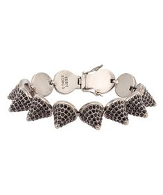 Eddie Borgo, Black Rhodium-Plated Pavé Cone Bracelet, £800.00. Fusing high end with street, Eddie Borgo started off creating one-of-a-kind pieces for stylists such as Patti Wilson and Tabitha Simmons. He launched his label in 2008. #libertyjewellery #libertyacc #eddieborgo